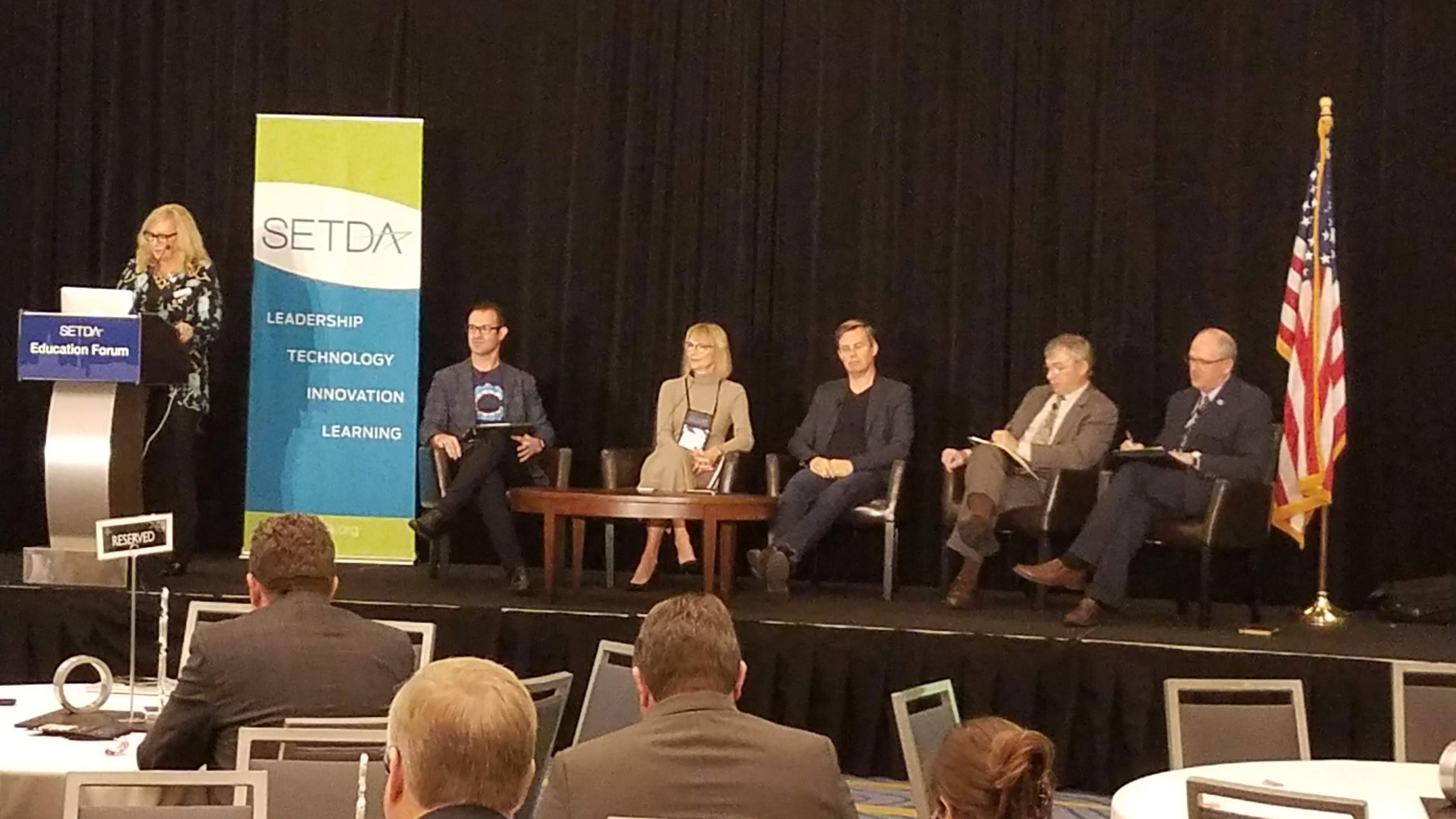 SETDA Panel on stage, with flag and logo banner